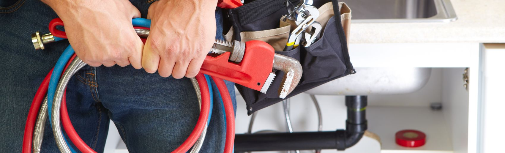 plumbing contractor with tools